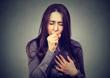 Portrait of a Young woman coughing