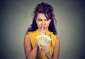 Fotografie Corruptive woman with money