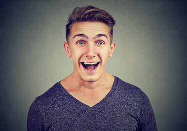 Man excited with surprised face expression