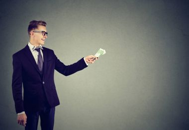 Formal young man loaning money