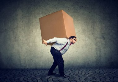 Chubby man delivering huge heavy box on back under great stress. stock vector