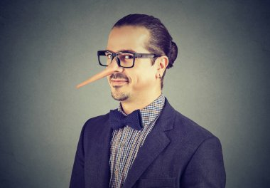 Man with long nose isolated on gray background. Liar concept.