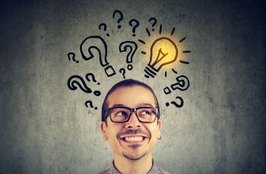 man with many questions and solution light bulb above head