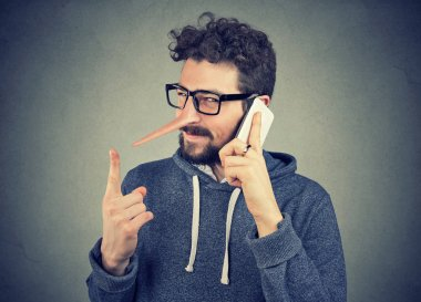 sly liar man with long nose talking on mobile phone