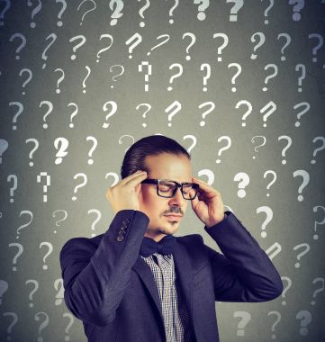 Stressed overburdened young man has too many questions