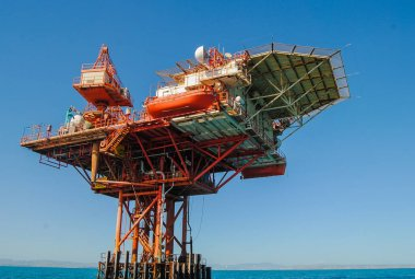 Abstract and conceptual pollution, oil platform at sea.