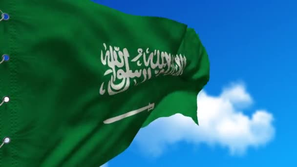 Am blauen Himmel weht die Flagge Saudi-Arabiens im Wind. Nationales arabisches Symbol