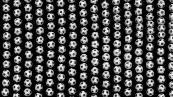 Large soccer balls forming fabric flag. Looped video. Black  screen.