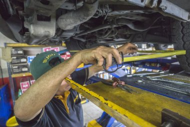 KUALA LUMPUR, 22 DEC 2016. Mechanic working in the car maintenence workshop. People working