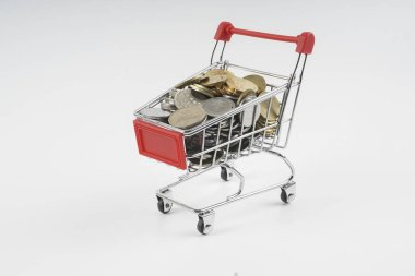 Trolley and coins isolated on white. Sales concept