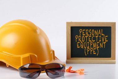 Yellow hardhat safety helmet,safety glass and ear plug isolated on white background with PERSONAL PROTECTIVE EQUIPMENT (PPE) words. Industrial safety and health conceptual. stock vector