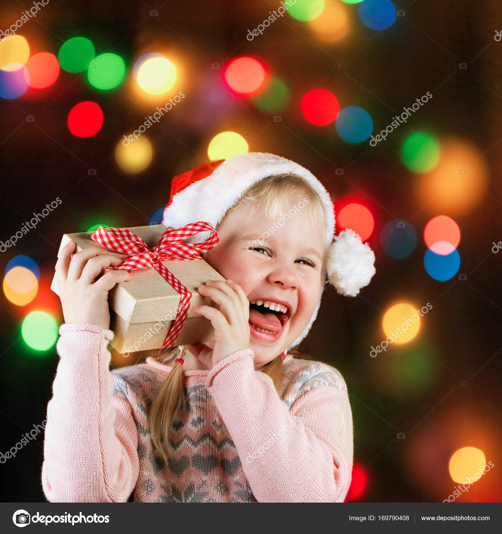 Little girl with christmas gifts. — Stock Photo © oxyzay #169790408