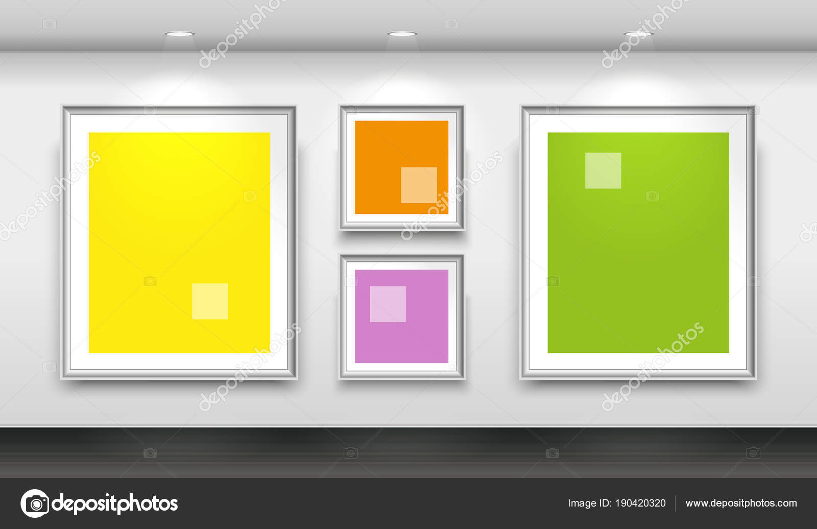 Galería interior con cuatro marcos blanco vacíos en la pared ...