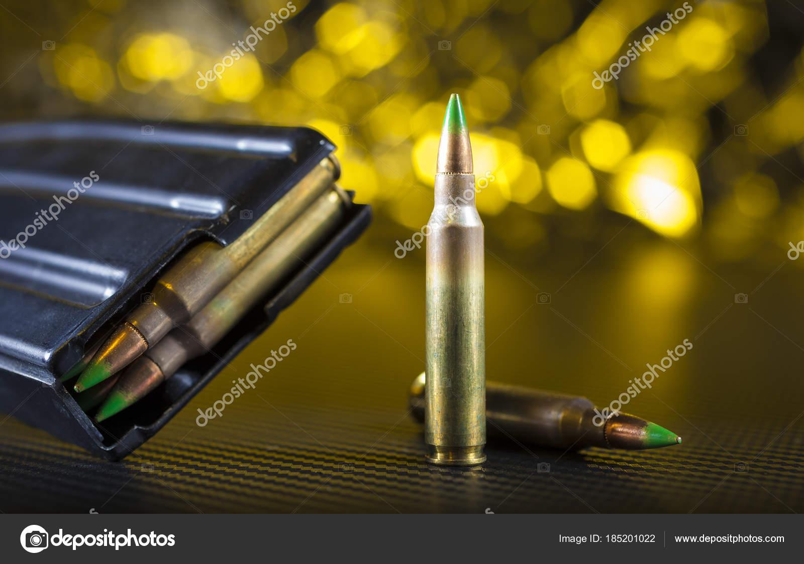 Green tipped AR-15 ammo and magazine — Stock Photo © gsagi