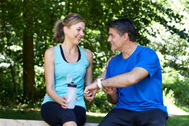 Mature Couple Exercising In Countryside Together