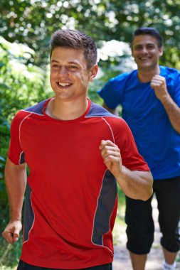 Two Men Running In Countryside Together
