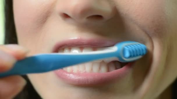 Close Up Of Woman Brushing Teeth With Manual Toothbrush