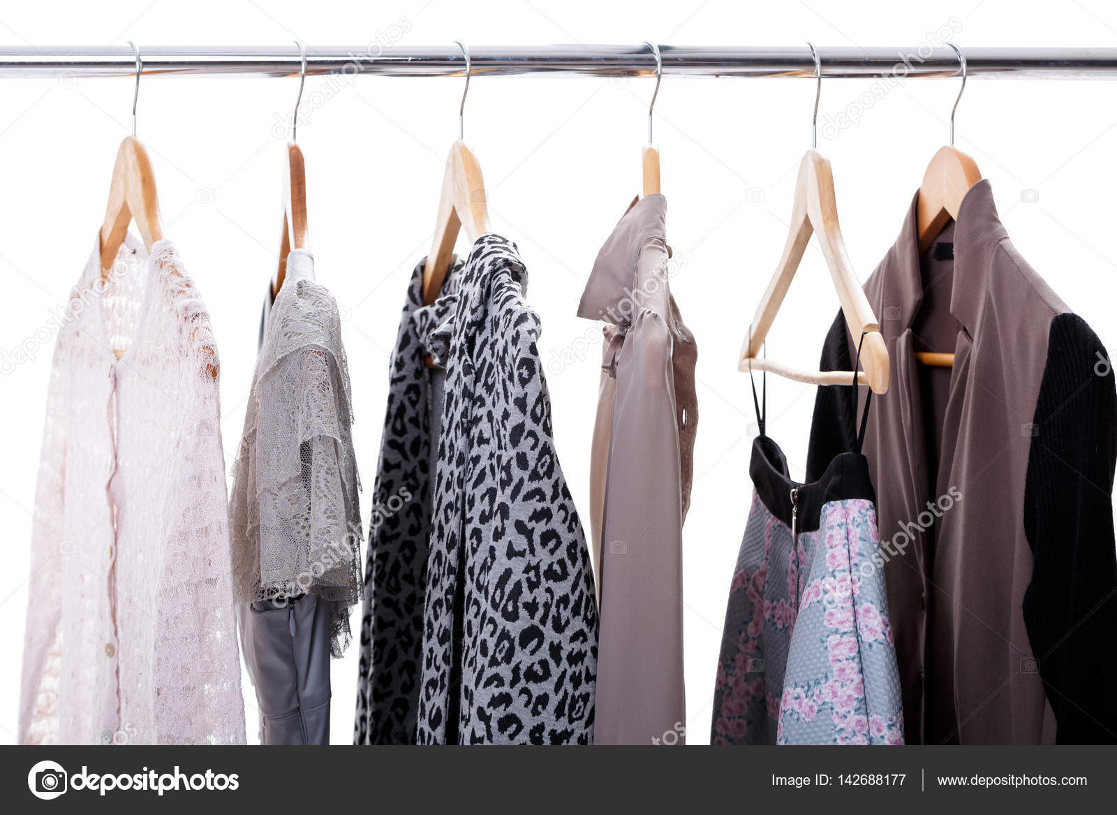540882945c2 Grey and beige womens clothes on hangers on rack on white backgr — Stock  Photo