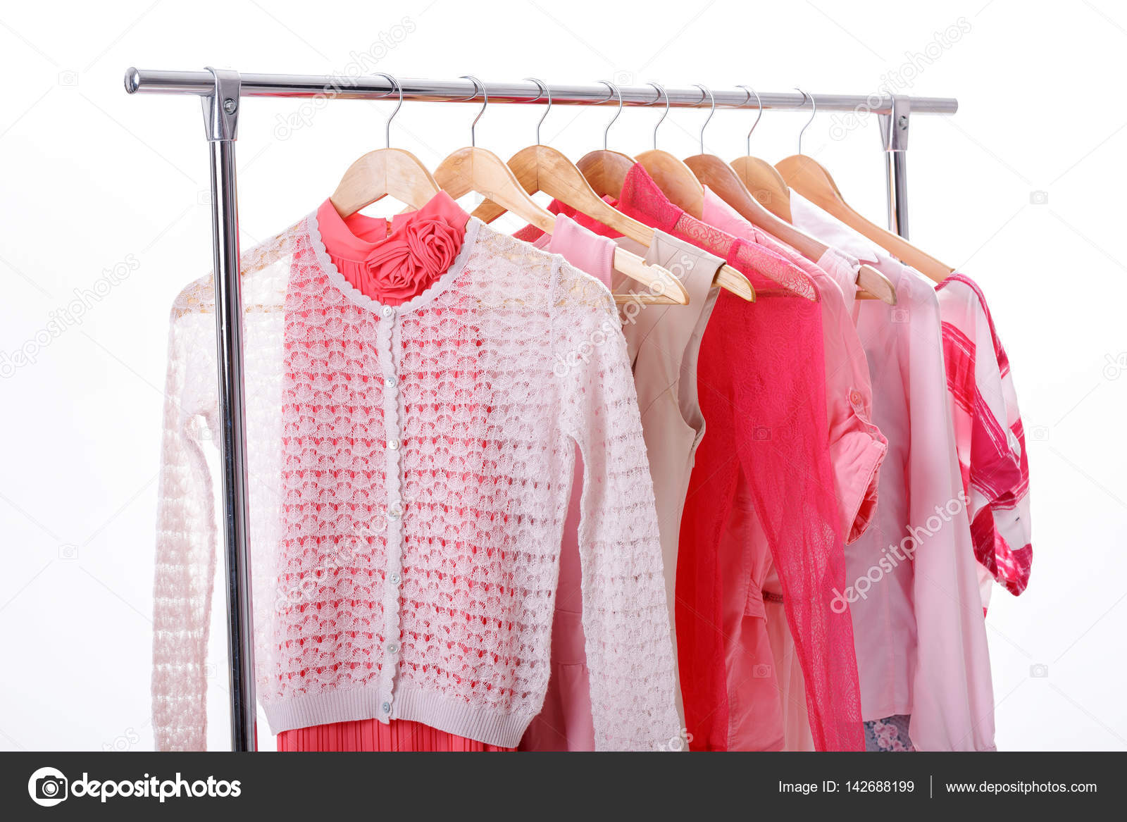 9f4158c8cbd Pink womens clothes on hangers on rack on white background. clos — Stock  Photo