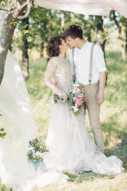 wedding couple on  nature.  bride and groom hugging at  wedding.
