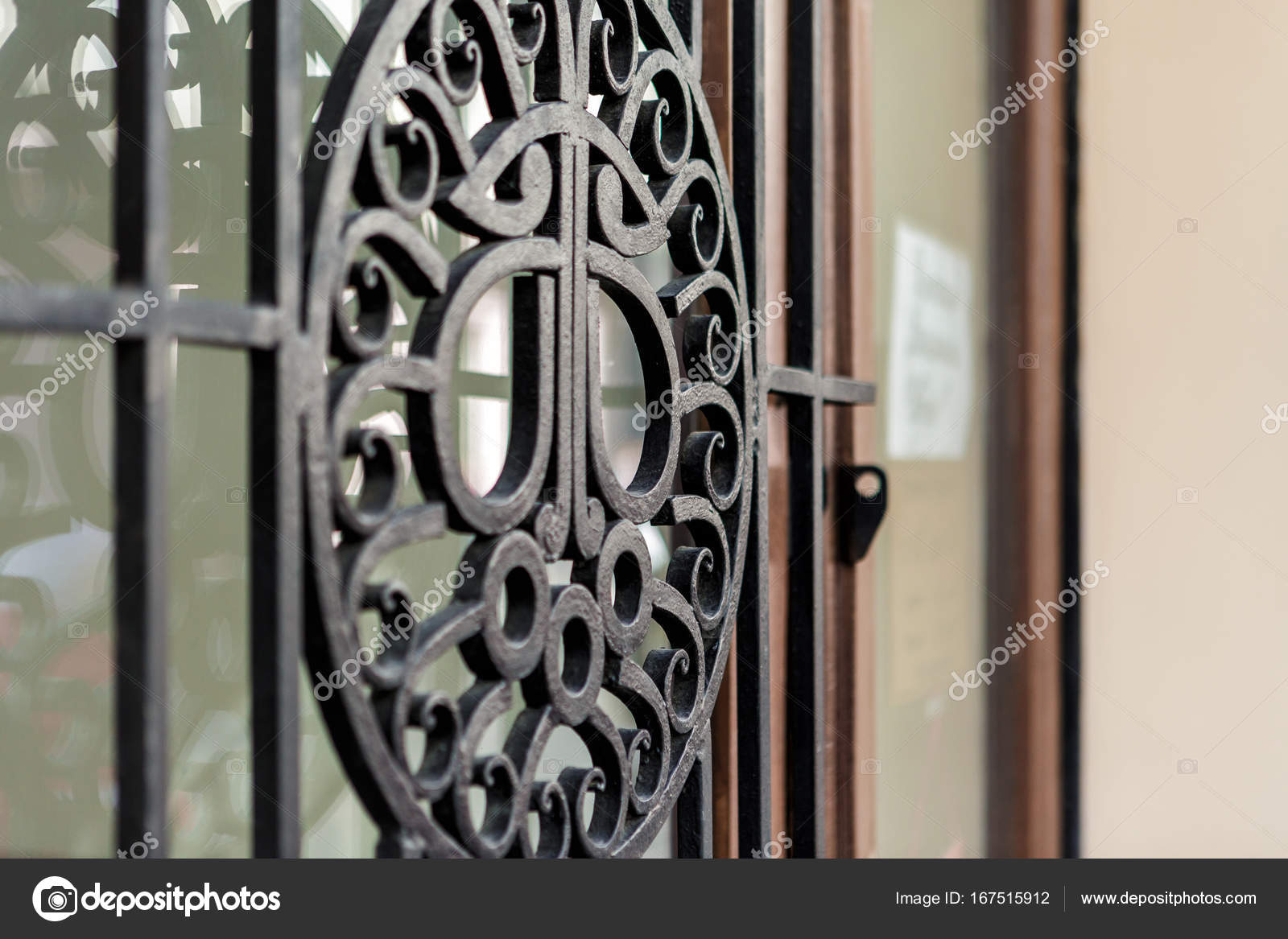 metal lattice window in the wall stock photo erstudio 167515912