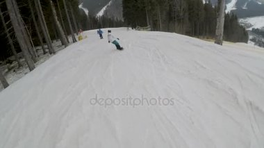 snowboarder snowboarding on slopes in Bukovel ski resort.