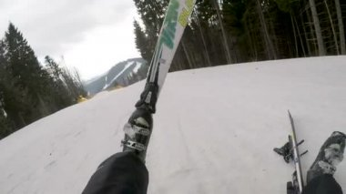 skiers fall on the slope