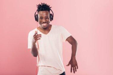 African-American man in headphones listening to music