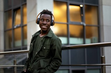 african-american man in wireless headphones listening music