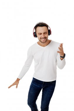 young man in headphones listening to music