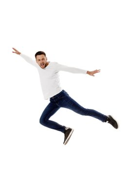 Handsome young bearded man jumping. Full length portrait over white background stock vector