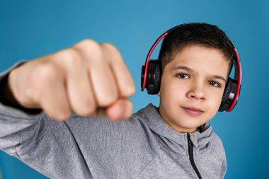 child boy enjoys listens to music in headphones