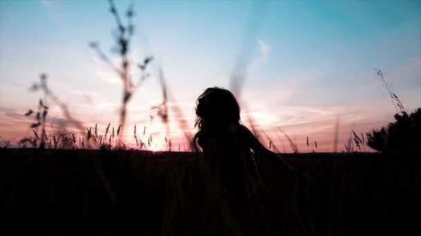 Silhouette of slender girl dance during the sunset.
