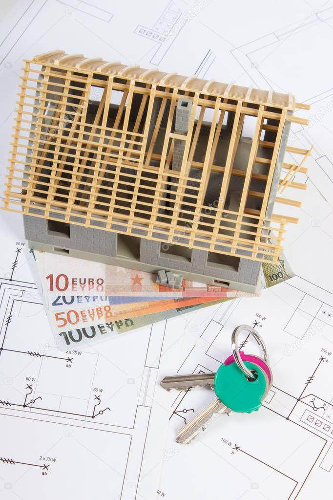 Haus im Bau, Schlüssel und Währungen Euro auf elektrische ...