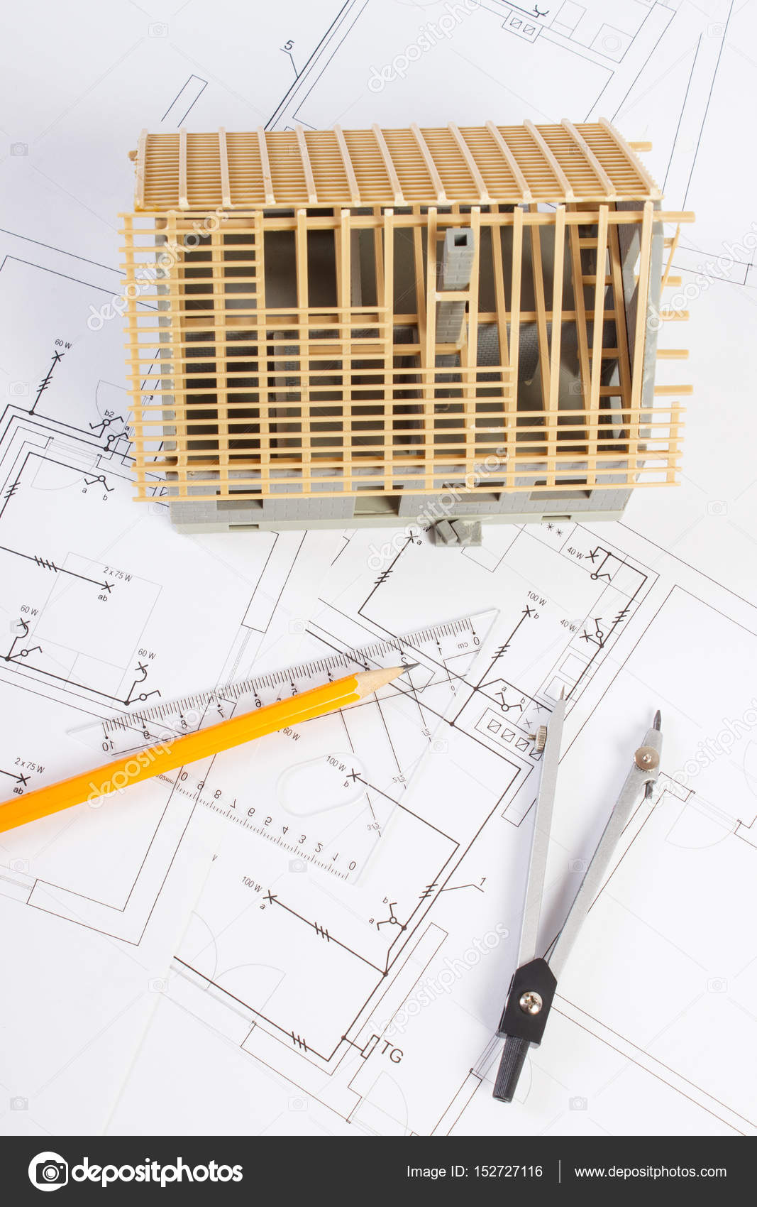 Casa en construcción y accesorios para la elaboración de diagramas ...