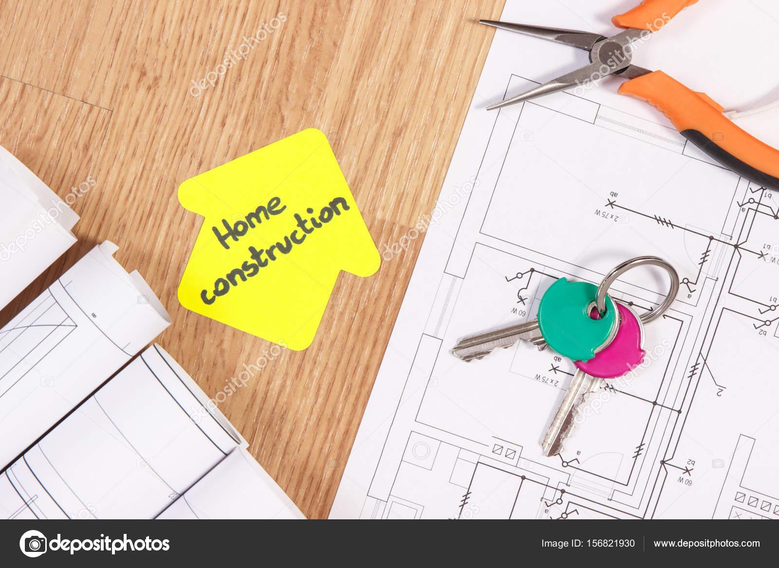 Home Tasten, Metall Zangen, Diagramme Oder Elektrische  Konstruktionszeichnungen Und Gelbem Papier In Form Eines Hauses Mit Text  Hausbau Konzept Des Gebäudes ...