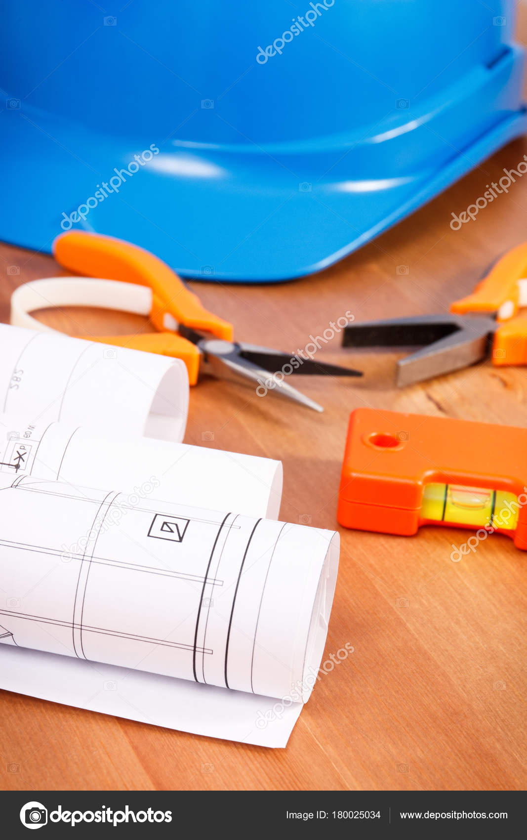 Electrical blueprint or drawings protective blue helmet and orange diagrams or electrical construction drawings protective blue helmet and orange work tools for engineer jobs photo by ratmaner malvernweather Image collections