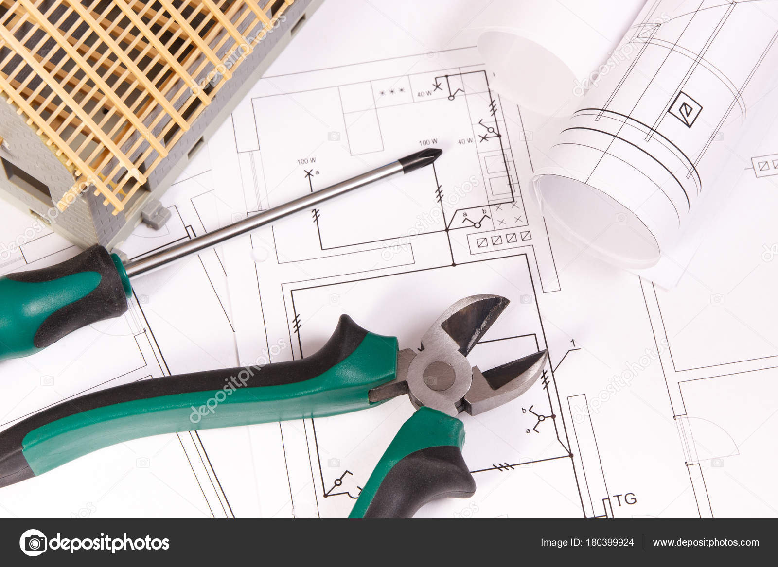 Electrical drawings, work tools and house under construction ...