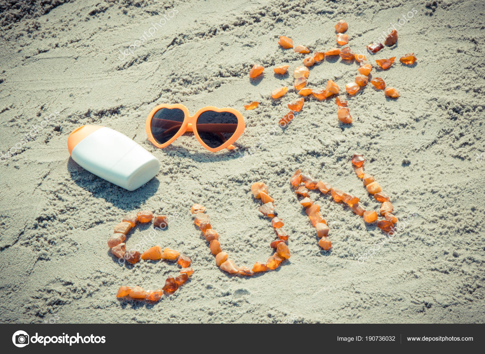vintage photo word and shape of sun sunglasses with sun lotion at beach
