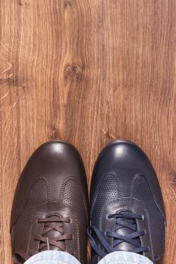 Comfortable casual different leather shoes on board, male footwear concept, place for text