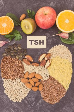 Nutritious natural ingredients in shape of thyroid. Healthy food as source vitamins and minerals. Problems with thyroid concept