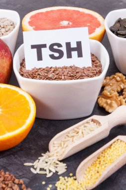 Inscription TSH with nutritious products and ingredients containing vitamins and minerals for healthy thyroid