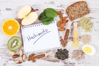 Notepad with inscription hashimoto and best nutritious ingredients or products for healthy thyroid