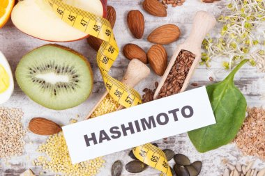 Inscription hashimoto, tape measure and best ingredients for healthy thyroid. Food containing natural minerals and vitamins