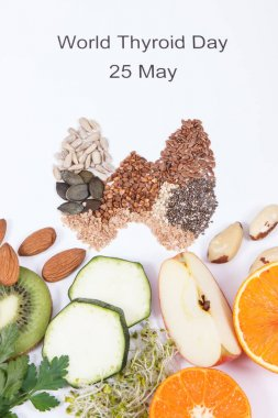 Fresh nutritious ingredients in shape of thyroid. Healthy food as source vitamins and minerals. World Thyroid Day and problems with thyroid concept