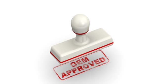 OEM approved. The stamp leaves a red imprint OEM APPROVED (Original Equipment Manufacturer approved) on white surface. Footage video