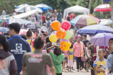 the market street at the traditional Longboat Race at the Khlong Chakarai River in the Town of Phimai in the Provinz Nakhon Ratchasima in Isan in Thailand. Thailand, Phimai, November, 2017.