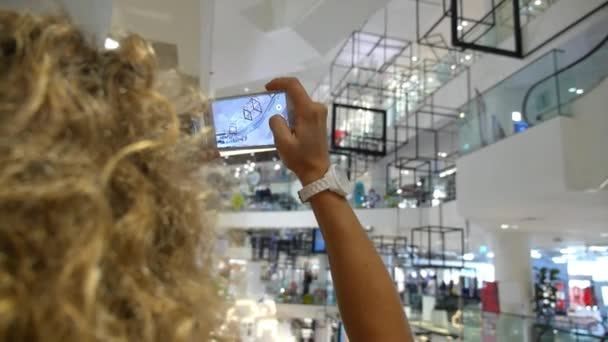 Woman Taking Picture With Smartphone Of Art Object In Gallery