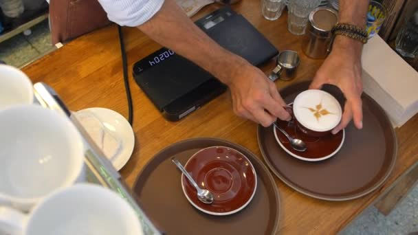 Man Barista Serving Cup of Cappuccino Coffee In Cafe