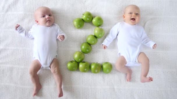 Cute Twin Two Months Babies In White Bodysuites